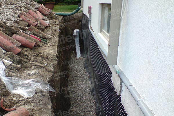 Weeping tile installation toronto aquatech waterproofing for Exterior drain tile installation