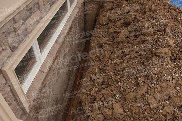 aquatech-waterproofing-exterior-trench-with-an-old-drainage-pipe