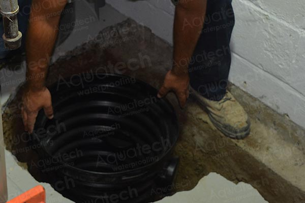 aquatech-waterproofing-sump-pump-applying-into-the-trenche